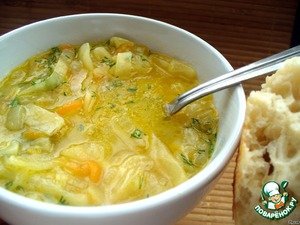 Onion soup with cabbage and lemon