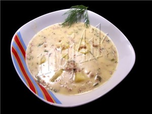 The soup is a creamy cheese with meat