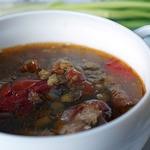 Красный суп со свининой и чечевицей