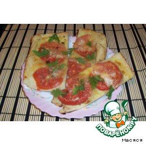 Рецепт Пирог с моцареллой и помидорами на слоеном тесте