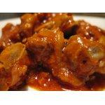Пикантное свиное рагу в томатном соусе