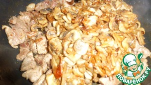 Then add the mushrooms to the meat and fry all together for 5-10 minutes.