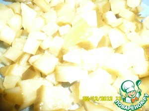 Cucumbers cut into cubes about 1 by 1 cm is Added to the pot along with the carrots.