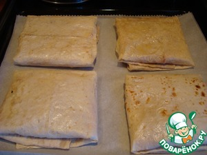 Again, grease the top and bottom with butter, spread on parchment and in the oven.