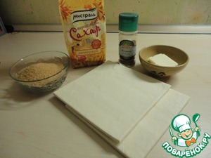Cooked products. Raisins poured for 15 minutes, washed, dried on a towel. The dough is thawed.