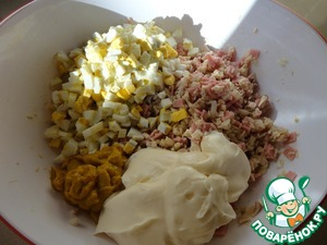 Then add in salad eggs, mustard and mayonnaise. Stir.