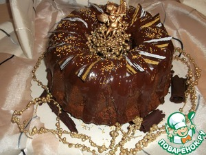 Chocolate (couverture) chop and melt on a steam bath. Pour the chocolate pudding and decorate.  The original recipe uses couverture, but it is possible to fill the cupcake with icing in your favorite recipe.