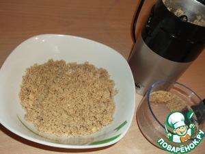 Walnuts grind in a coffee grinder.