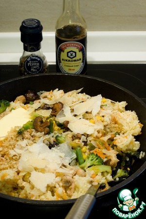 Stir the cooked rice to the vegetables with the chicken, add the Parmesan, butter, soy sauce and pepper.  Serve immediately!  Happy holidays!