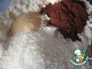 Муку перемешаем с разрыхлителем, ванильным сахаром, какао и кокосовой стружкой.