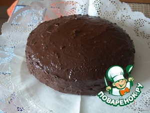 """Assemble the cake and pour chocolate glaze.  For frosting: melt 200 g dark chocolate 50 g of butter. Ready glaze cool until the moment when it can easily be applied on the cake and not run off. If the icing is still glass, then wait for its solidification, and collecting it from the edges of the dish using a pastry spatula, apply on the side of the cake.  The biscuit is supposed to be very airy, light, not wet. The consistency similar to a sponge. Slightly crumble. To serve cake """"Sacher"""" recommended fresh with freshly whipped, slightly sweetened cream. Of great importance in the recipe has a chocolate coating. Experts say that the secret lies in the chocolate glaze, which is produced from three varieties of chocolate, which are made exclusively for the glaze Sacher-cake. These varieties of chocolate go to the hotel from lübeck and Belgium. I tried to do different variations of glaze, most often in the Internet, it is so-called """"Fondant"""" (Eng.)- a coating of sugar syrup and melted chocolate. But of all the tested variants most like: butter with chocolate. It seems more gentle, not so hard in the preparation and coating is always obtained """"velvet"""" shiny, not matte. Watch this video on how to expertly apply the glaze: http://www.youtube.c om/watch?v=uHQNqLwVP dY&feature=related So prepare cake in Vienna. :-)"""