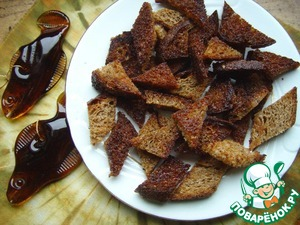 Slices of bread cut into small pieces and saute in butter or vegetable oil.