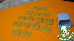 Cut squares for the base of the trees using molds for cookies.
