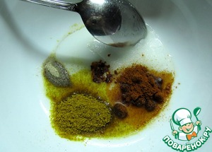 All the spices mix with the oil
