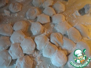 The formed dumplings covered with flour.