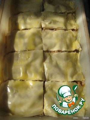 After put all of the batter on top pour the remaining oil and, using a sharp knife, cut the dough into portion squares (see photo).