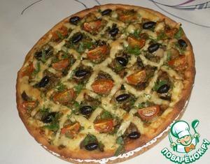 Выпекать пиццу при 200*С в течение 20 минут. Готовую пиццу посыпать свежей зеленью.