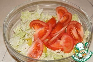 Add slices of tomatoes and again very gently stir, trying not to crush the vegetables.