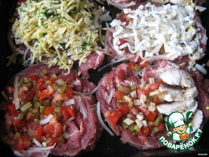 Protiven grease with vegetable oil.  Put pieces of meat. Meat on one side lay the cucumbers, the tomatoes, the other straightened a fan of the mushroom caps (leg spread evenly over the piece), then onion, mayonnaise, cheese  Cook at 240 degrees. until tender