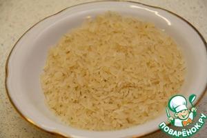 Промойте 3-4 раза рис.
