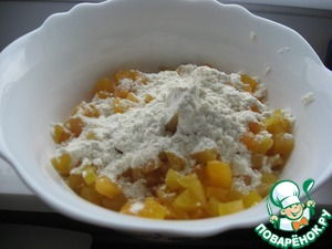If fresh apricots, then scald with boiling water, then pour cool and remove the skin, remove the bones.   If from the can, drain off juice.  Cut into pieces. Mix the chopped apricots with a small amount of flour (plain).