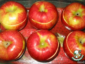 Then cover with the lids cut off, put in shape, oiled. Bake at 200 degrees until soft 20-35 minutes, it depends on the apples.