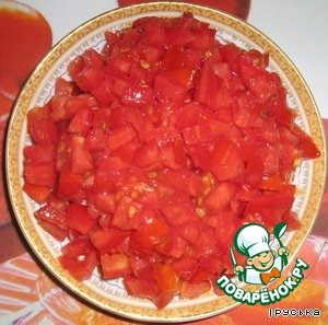The tomatoes finely cut into cubes.