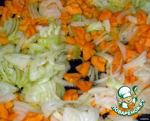 Cut and saute onions and carrots in vegetable oil.