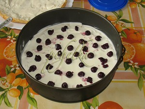 to put some of the cream on top, and lightly press the cherries, another cake+cream and cherries, etc.