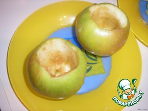 Using a knife and spoon from two of the apples, scoop out the flesh. We stuffed two apples, the third will go on top.
