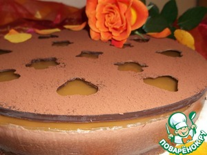 Using a long knife or blade to move the chocolate around on the surface of the cake.