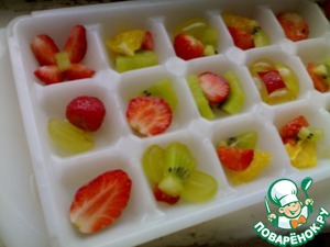 Put the fruit into molds for ice.