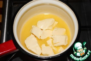 Cut slices of the butter and melt on low heat (do not boil!).  Dissolve sugar, salt and soda (not slaked) in melted butter.