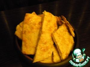 Разогреть духовку до 180 С. Выложить лепешки на противень, покрытый бумагой для выпечки (как вариант - присыпать противень сухарями).       Выпекать 12-15 минут до золотистого цвета. Подавать лепешки к столу теплыми, разломав по намеченным линиям.