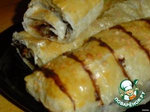Finished rolls decorate warmed hazelnut cream.