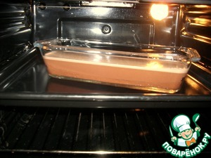 Send in a preheated oven at 150*C in a water bath (place the form in a baking tray filled with boiling water to half of the form).