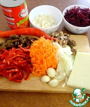 Boil the rice until soft.  Carrots, beets, peel and grate on a medium grater.  Onion cut into half rings.  Nuts chop with a knife.  Cheese grate on medium grater.  Pepper cut into strips (1 PCs).