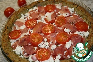 Then cut tomatoes in slices and lay them on the ham.  Repeat layers twice: on the tomatoes, crumble goat cheese, ham, tomatoes.