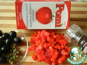 "Tomatoes peel and cut into small cubes. Then chopped tomatoes and pureed ""Pomi"" spread on a pan, bring to the boil."