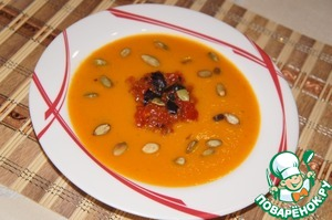 On a dry frying pan roast pumpkin seeds.  In a bowl pour the pumpkin part of the soup, put the tomato sauce, garnish with Basil leaves and pumpkin seeds.