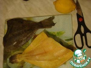 Meanwhile, prepare the carcass: cut fins, sprinkle with salt, pour lemon juice.