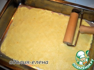 One part white dough roll out on paper and with paper to transfer to the form.