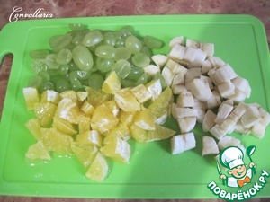 Banana and oranges cut into cubes, grapes in half.