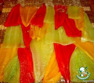 Peppers cut into two halves. Laid on the Mat.