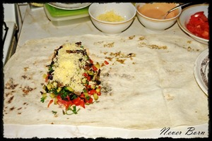 The filling laid out as follows: first a layer of meat, then tomatoes, greens, peppers, pickles, mushrooms and cheese.