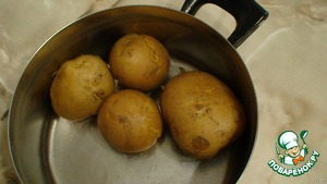 Boil potatoes in their skins until soft