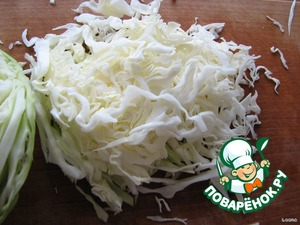 Meanwhile, thinly slice the cabbage.