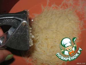 Grate cheese on a small grater, squeeze in the garlic.