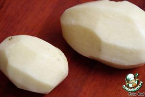 Peel the potatoes, boil until tender.