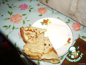 In this photo, the pancakes with sour cream!  Bon appetit!